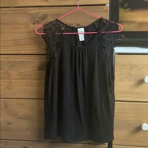 Black top with lace cap sleeves